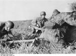 German paratroopers preparing a field gun for action, Nettuno, Italy, Feb 1944