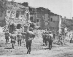 Troops of US 3rd Division entering Valmontone, Italy, circa May 1944