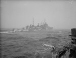 British cruiser HMS Trinidad escorting an Allied Arctic convoy, seen from HMS Fury, 1942