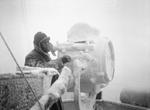 Ice forming on a 20-inch signal projector on the cruiser HMS Sheffield while escorting a convoy in the Norwegian Sea or Barents Sea, Dec 1941