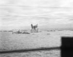 A German bomb detonating underwater near HMS Ashanti, HMS Wheatland, and HMS Eskimo which were escorting Allied convoy PQ-18, Sep 1942