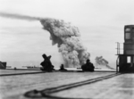 Smoke rising from ammunition ship Mary Luckenbach of Allied convoy PQ-18, 13 Sep 1942; seen from flight deck of carrier, possibly HMS Avenger