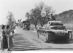 German Panzer II tank commander waving to Austrian women, Austria, 13 Mar 1938