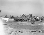 Unloading equipment on a beach near Salerno, Italy, Sep 1943