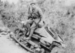 Greek soldier posing with a wrecked Italian L3/33 tankette during the Battle of Elaia-Kalamas, northern Greece, early Nov 1940