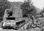 German vehicles in Yugoslavia or Greece, Apr 1941; sIG 33 self-propelled gun at left, DKW NZ350 motorcycle at right, SdKfz 10 in background