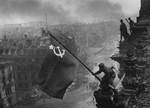 Red Army soldier Mikhail Alekseevich Yegorov of Soviet 756 Rifle Regiment flying the Soviet flag over the Reichstag, Berlin, Germany, 2 May 1945, photo 1 of 2