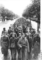 Soviet soldier with PPD submachine gun with a column of German prisoners of war, Berlin, Germany, May 1945