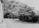 US 55th Armored Infantry Battalion men and US 22nd Tank Battalion tank in Wernberg, Bayreuth, Germany, 22 Apr 1945
