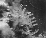 American bombs falling on Kobe, Japan, 4 Jun 1945