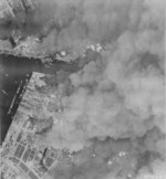 Osaka, Japan burning during an American raid, 1 Jun 1945, photo 1 of 2