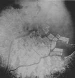 Aerial view of Tokyo, Japan after the 9 Mar 1945 raid, circa 10-15 Mar 1945; photo 2 of 3