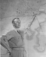 US officer pointing at Tokyo, Japan on an enlarged map during a bomber crews briefing, Saipan, Mariana Islands, late Nov 1944