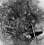 German He 111 bomber in flight northbound over Surrey Docks, London, England, United Kingdom at 1700 hours on 7 Sep 1940, photo 1 of 2