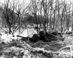 Machine gun post manned by men of 1st Battalion, 157th Regiment, US 45th Division near Bastogne, Belgium, 10 Dec 1944; note M1919 Browning machine gun