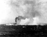 Lexington under dive bomber attack during Battle of Coral Sea, shortly before noon on 8 May 1942