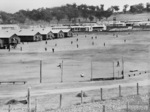 Japanese prisoners of war practising baseball at No. 12 Prisoner of War compound near Cowra, NSW, Australia, 1 Jul 1944