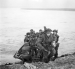 Men of the UK 15th Scottish Division leaving their assault craft after crossing the Rhine River near Xanten, North Rhine-Westphalia, Germany, 24 Mar 1945