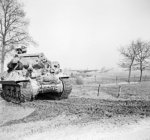 British Achilles tank destroyer on the east bank of the Rhine River, 26 Mar 1945; note abandoned gliders in background