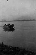 1st Squad of A Company of US 150th Combat Engineer Battalion crossing the Rhine River in Germany by an US Navy landing craft, 23 Mar 1945