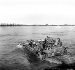 Men of the British 5th Dorsetshire Regiment crossing the Rhine River into Germany in a Buffalo tracked landing vehicle, 28 Mar 1945
