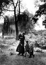 A Dutch family amidst a devastated town after the German invasion, May 1940
