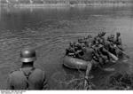 German troops crossing the Meuse River in a rubber raft, near Aiglemont, France, 14 May 1940