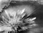 Bomb dropped by Japanese pilot Kazumi Horie exploding on the flight deck of USS Enterprise during Battle of the Eastern Solomons, 24 Aug 1942