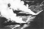 Two beached Japanese transports burning after US aerial attack near Tassafaroga, Guadalcanal, 15 Nov 1942