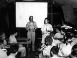 Captain William Sterling Parsons and Colonel Paul Tibbets, Jr. briefed the crew of B-29 Superfortress