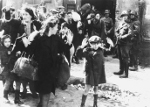 Jewish boy Artur Dab Siemiatek, Levi Zelinwarger, or Tsvi Nussbaum being rounded up by Josef Blösche and other SS troops, Warsaw, Poland, Apr-May 1943