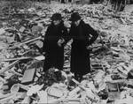Two women amidst a wrecked building, Newbury, Berkshire, England, United Kingdom, 11 Feb 1943