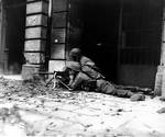 Browning M1919 machine gun crew of 2nd Battalion, US 26th Infantry in the streets of Aachen, Germany, 15 Oct 1944