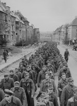 German prisoners marching along Joseph-von-Görres-Straße, Aachen, Germany, circa late Oct 1944
