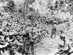 American soldiers resting during the Bataan death march, May 1942, photo 2 of 3