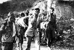Captured Japanese photograph of Americans POWs carrying the sick and the wounded during the Bataan Death March, Philippine Islands, Apr 1942