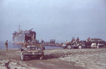 LST-1 landing US Army trucks and field guns onto a beach near Salerno, Italy, Sep 1943