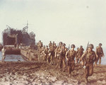LST-1 landing troops onto a beach near Salerno, Italy, Sep 1943