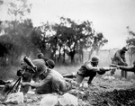 African-American troops of the US 92nd Infantry Division shelling Germans with their mortar rounds near Massa, Italy, circa Nov 1944