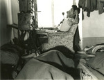 Japanese-American switch operator of US 442nd Regimental Combat Team at a foward command post, Castellina Sector, Italy, 12 Jul 1944; note other switch operators sleeping in same room