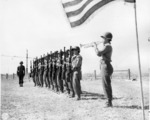 Japanese-American soldiers of 2nd Battalion, US 442nd Regimental Combat Team playing taps after riflemen fired salute, memorial ceremony for the fallen, Cecina area, Italy, 30 Jul 1944
