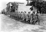 Japanese-American troops of US 442nd Regimental Combat Team marching through Vada, Italy, 1944
