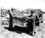 Japanese-American troops of 100th Infantry Battalion, US 442nd Regimental Combat Team inspecting a confiscated German field kitchen, Brescia, Italy, 18 May 1945, photo 2 of 2