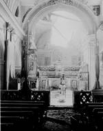 Private Paul Oglesby of US 30th Infantry Regiment standing before an altar in a damaged Catholic Church at Acerno, Italy, 23 Sep 1943