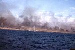 Explosions at the beach edge, with smoke rising from other hits just inland on Iwo Jima, probably during the pre-landing bombardment, 19 Feb 1945