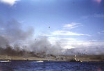 A LCS(L) and three Corsair aircraft bombarded an Iwo Jima Beach as two LVTs moved toward shore, 19 Feb 1945