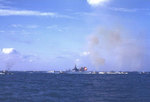 Battleship Tennessee fired her 14-inch guns at targets on Iwo Jima as LVTs headed for the landing beaches, 19 Feb 1945, photo 1 of 2