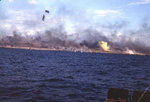 Explosions and yellow signal smoke just offshore and on Iwo Jima, 19 Feb 1945, photo 1 of 2
