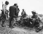American Marines fed Japanese POWs K rations, Iwo Jima, Feb 1945