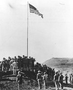 The official flag raising at the American Headquarters on Iwo Jima immediately after Nimitz